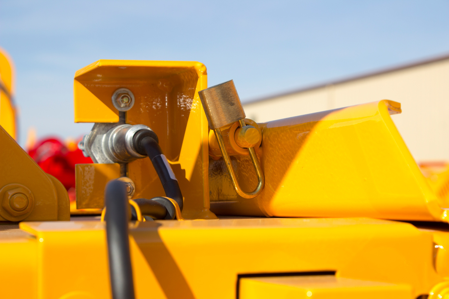 "On disc-style chippers, Bandit also installs a patented safety feature called the ""Hood Spring-Lock Pin""."