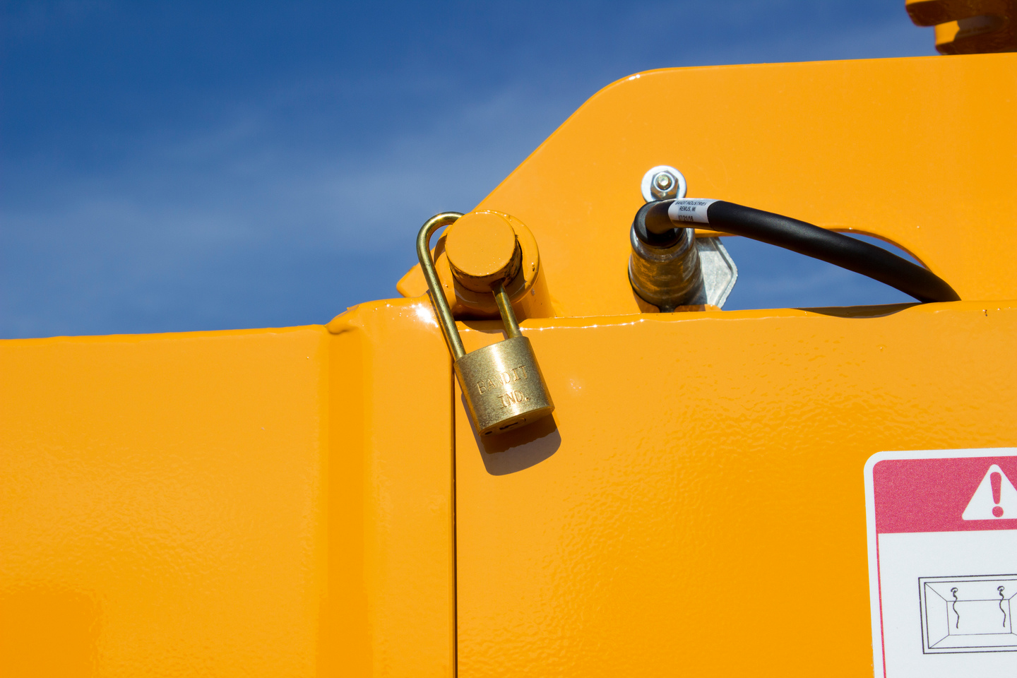 All Brush Bandit hand-fed chippers are equipped with a chipper hood lock pin