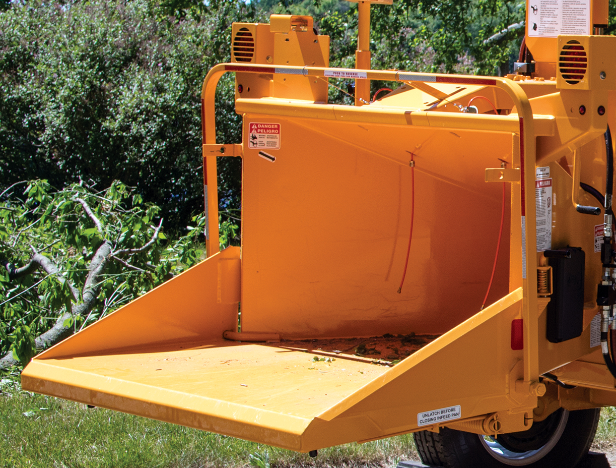 The control bar wraps around three sides of the infeed chute and controls feed wheel direction.